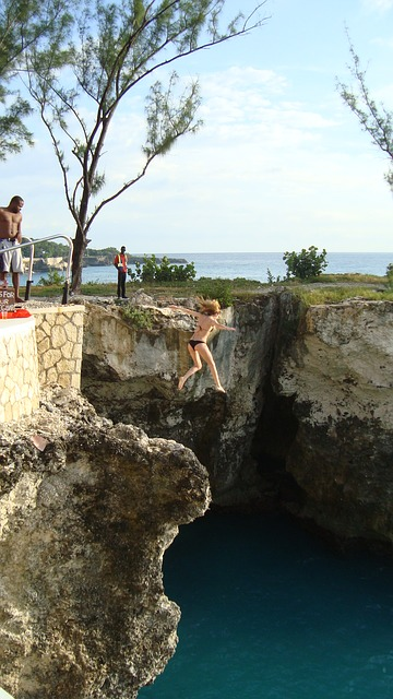 A girl cliff jumping at Ricks cafe_Negril_Jamaica_PD