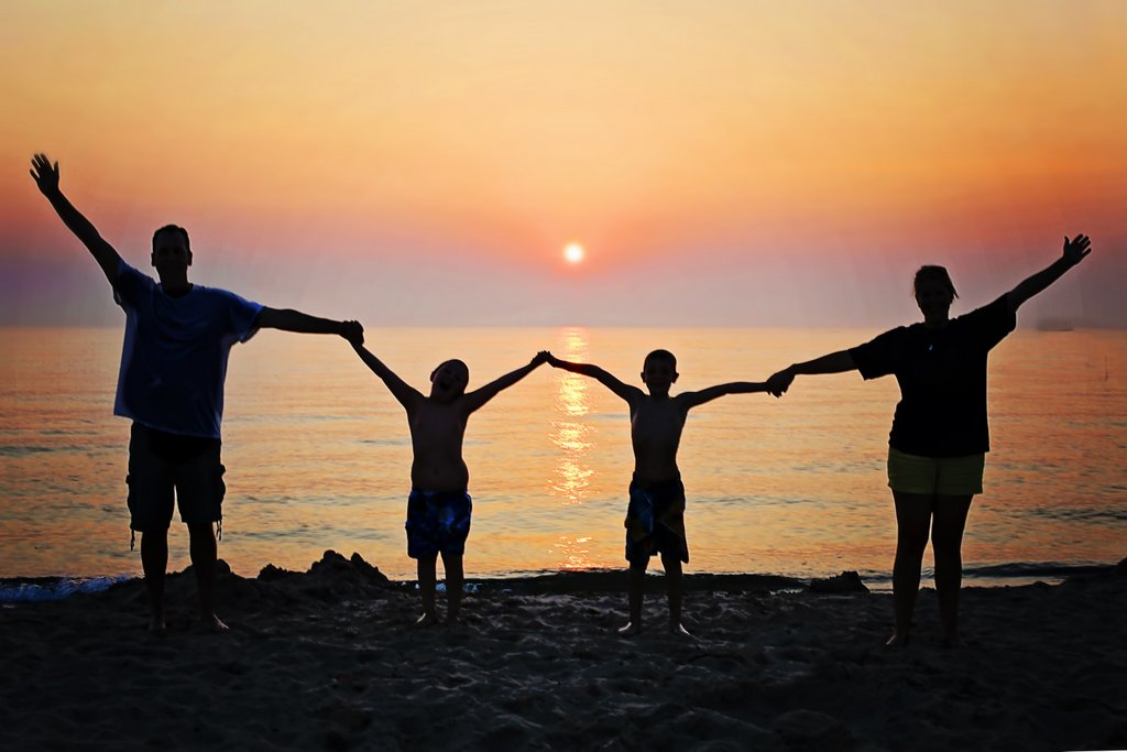 family-sunset-beach-happiness