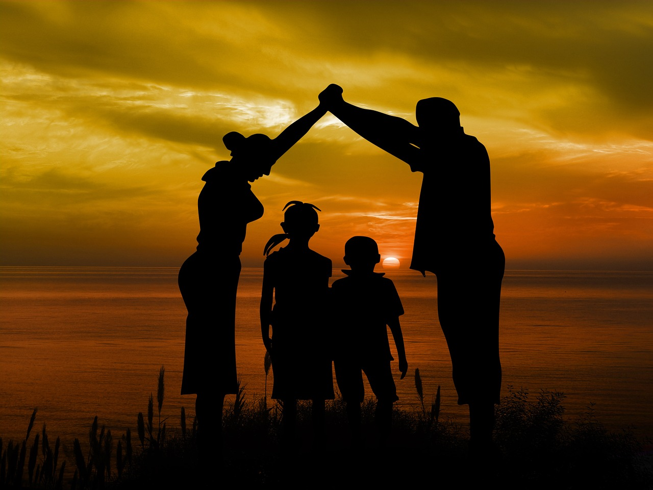 family-children-parents-sunset-boy-girl-sea-sun-protection