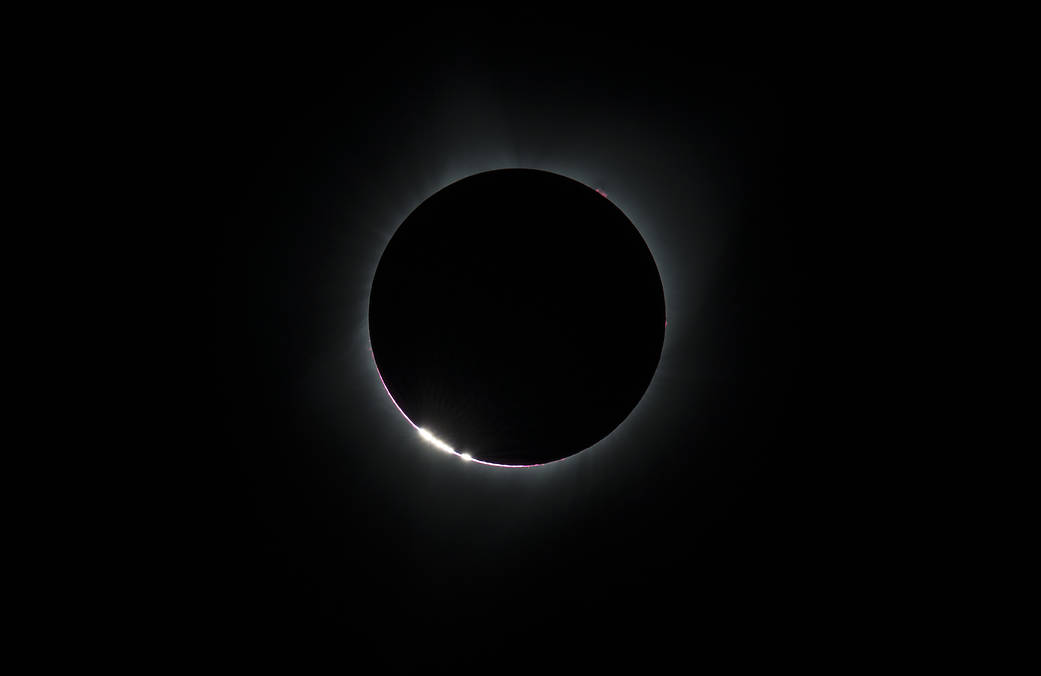 solar-eclipse-2017. NASA. The Bailey's Beads effect is seen as the moon makes its final move over the sun during the total solar eclipse on Monday, August 21, 2017 above Madras, Oregon. A total solar eclipse swept across a narrow portion of the contiguous United States from Lincoln Beach, Oregon to Charleston, South Carolina. A partial solar eclipse was visible across the entire North American continent along with parts of South America, Africa, and Europe.