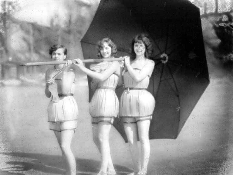Spruce_Girls_wearing_wood_veneer_bathing_suits_holding_an_umbrella_Washington