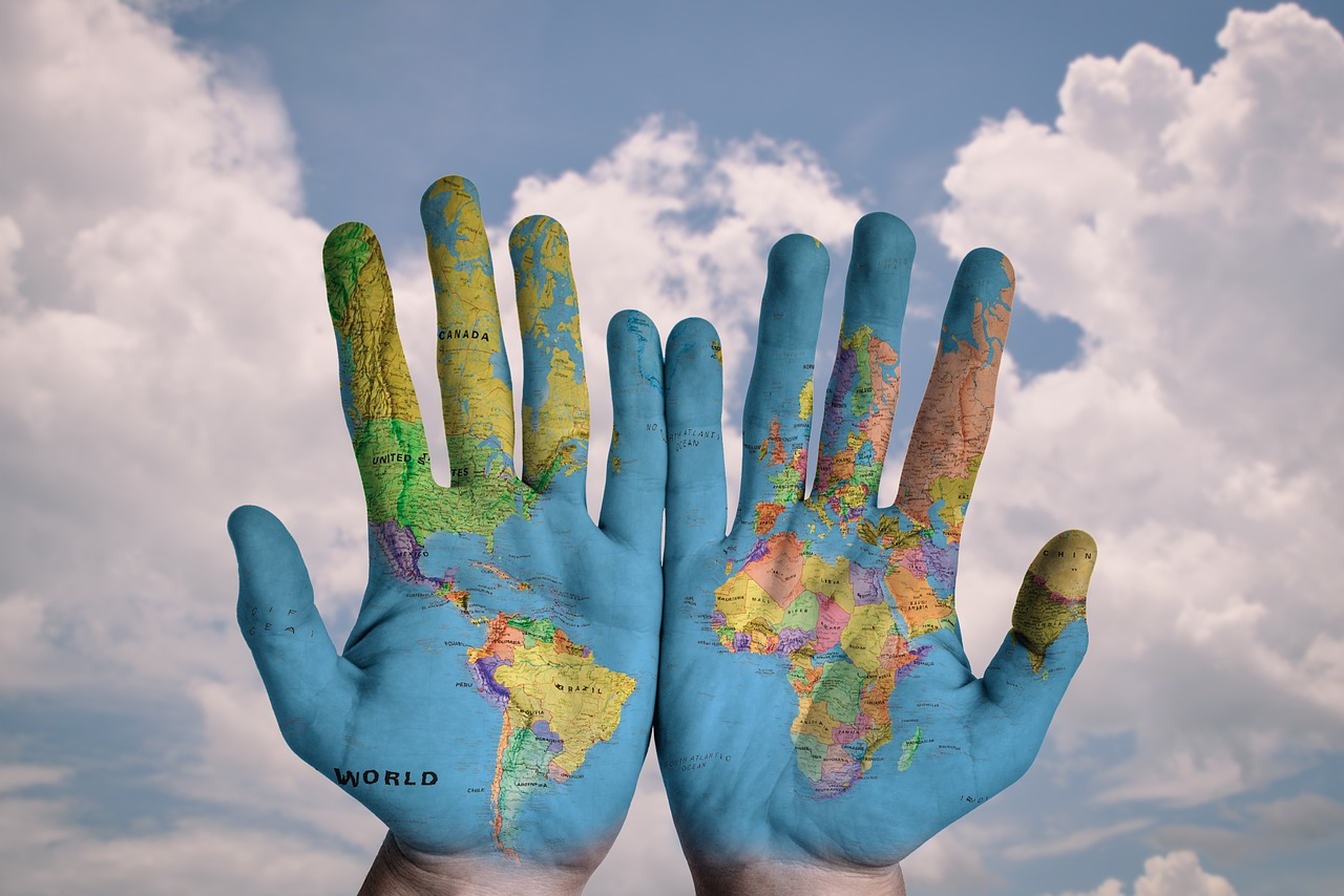 travel and lifestyle challenges_hands_world map_creative_PD