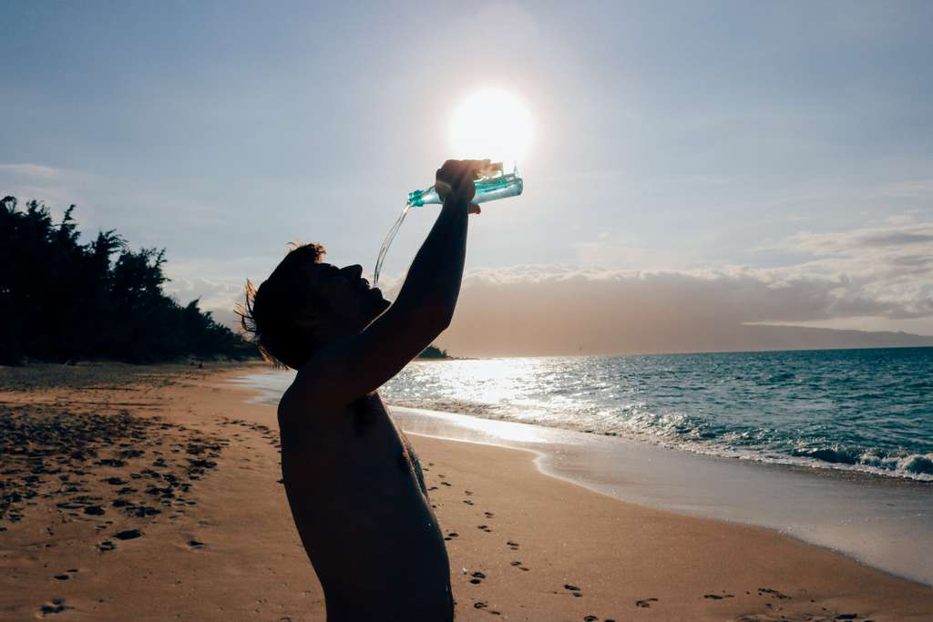 man-male-drinking-water-beach