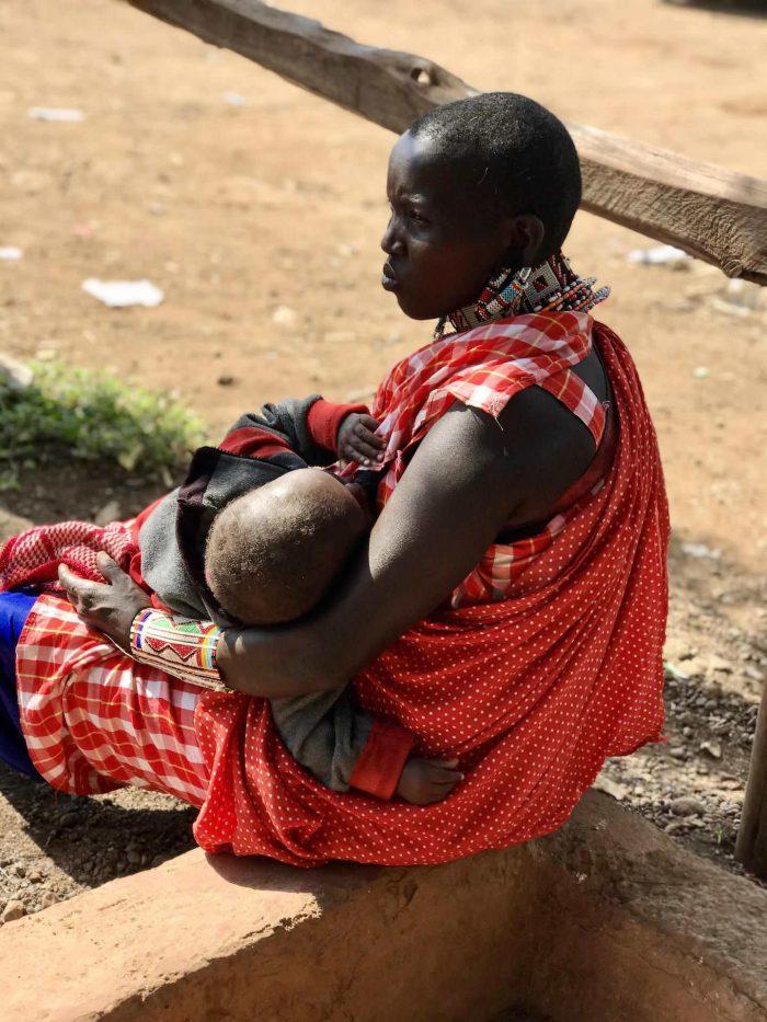 A Maasai lady feeding her baby_Kenya tribe_Africa_AOT