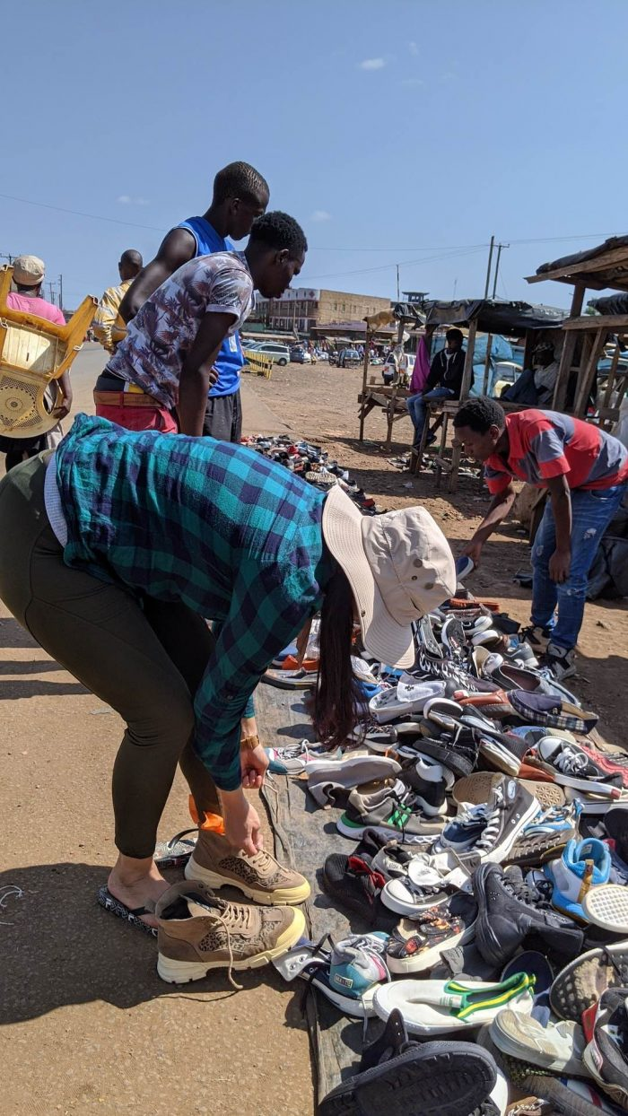 Neha buying shoe in Kimana Kenya Africa_AOT